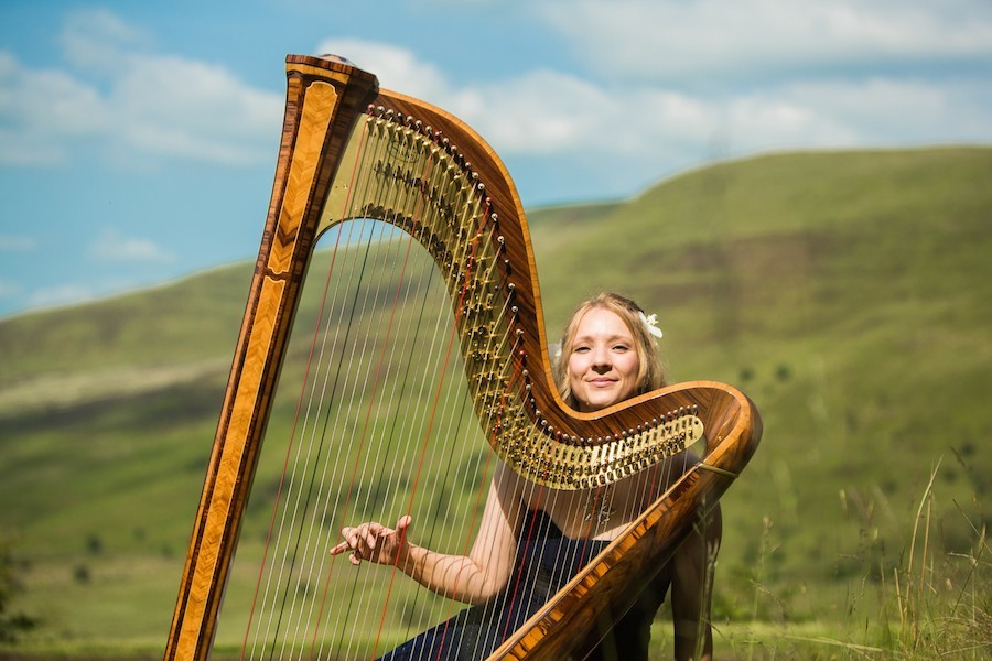 Shelley Fairplay performing harp outdoors